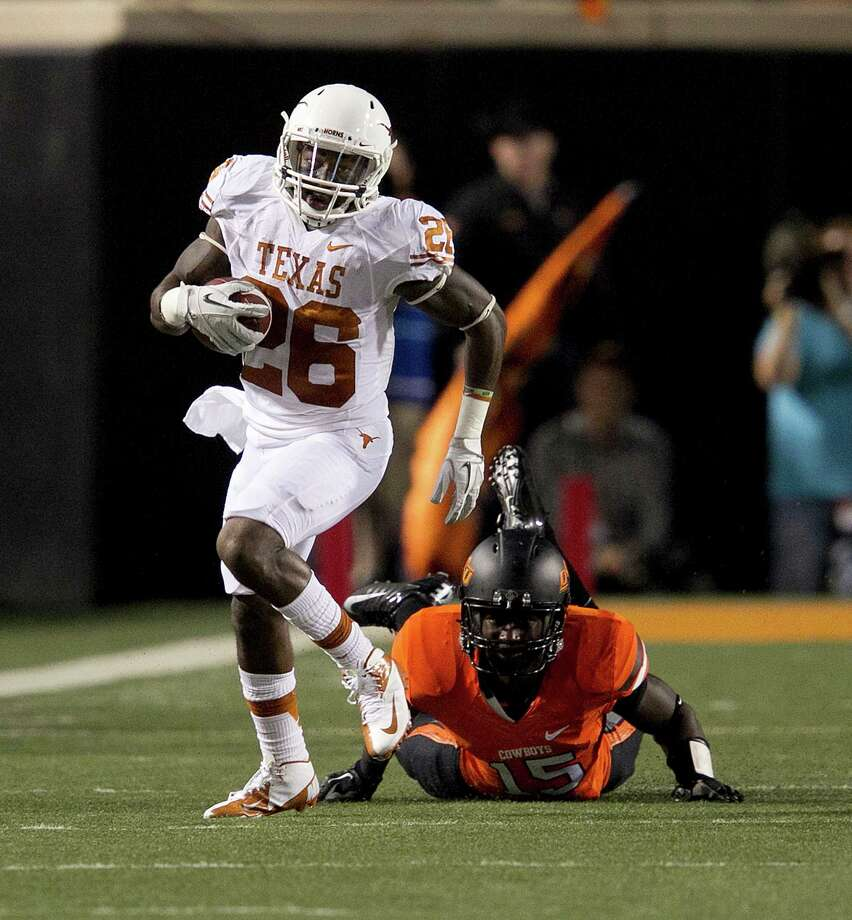 Texas's D.J. Monroe runs out of the Oklahoma State defense on his way to a touchdown during the first quarter in Stillwater, Oklahoma, on Saturday, September 29, 2012. (Deborah Cannon/Austin American-Statesman/MCT) Photo: Deborah Cannon, McClatchy-Tribune News Service / Austin American-Statesman