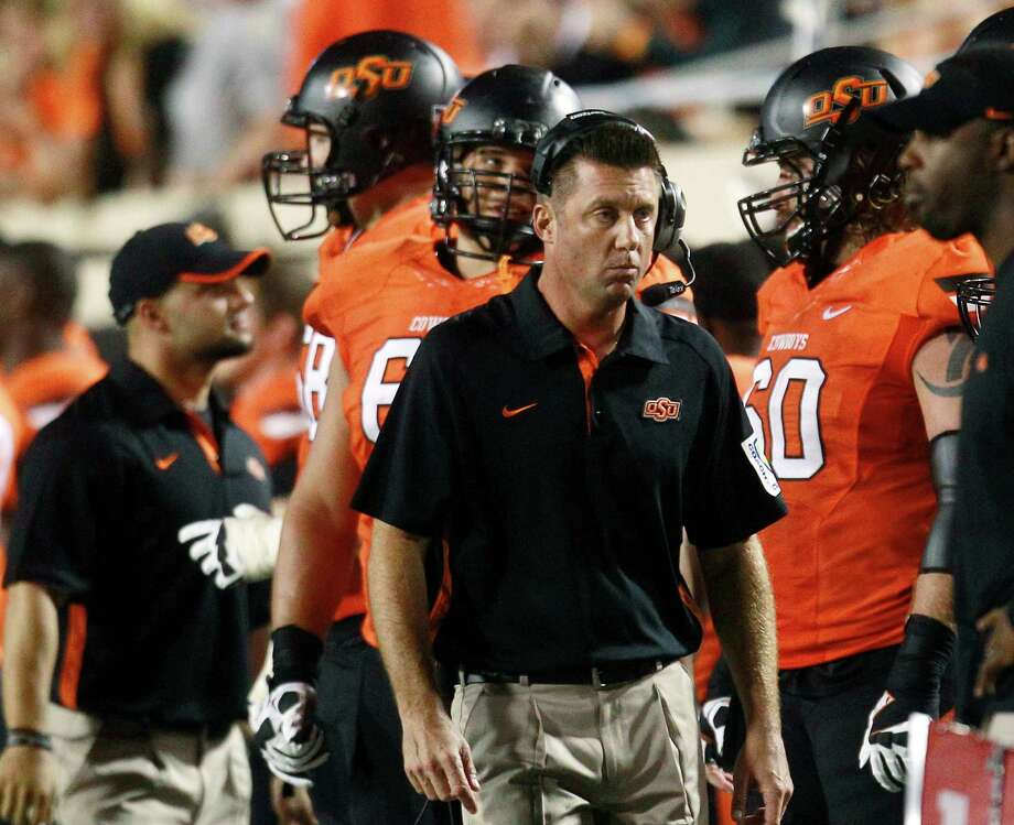 Mike Gundy and the Cowboys will call Reliant Stadium home on Aug. 31. Photo: Sue Ogrocki, Associated Press / AP