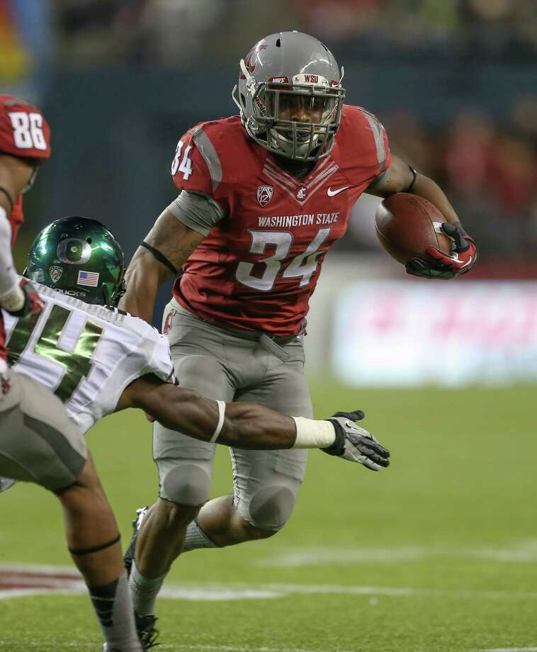 SEATTLE, WA - SEPTEMBER 29:  Running back Teondray Caldwell #34 of the Washington State Cougars rushes against cornerback Ifo Ekpre-Olomu #14 of the Oregon Ducks on September 29, 2012 at CenturyLink Field in Seattle, Washington. Photo: Otto Greule Jr, Getty Images / 2012 Getty Images