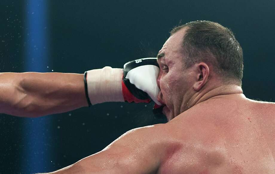 He knows how to take a punch:Alexander Ustinov (right) of  Belarus blocks the left jab of European heavyweight champion Kubrat  Pulev of Bulgaria with his nose during a title bout in Hamburg, Germany.  Despite using his face repeatedly to counter many of Pulev's blows,  Ustinov was knocked out in the 11th. Photo: Gero Breloer, Associated Press