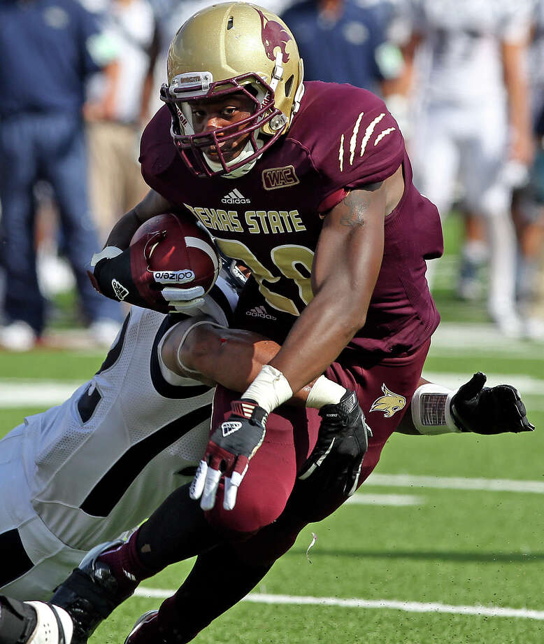Marcus Curry runs for the Bobcats as Texas State hosts Nevada at Bobcat Stadium on September 29, 2012. Photo: Tom Reel, Express-News / ©2012 San Antono Express-News