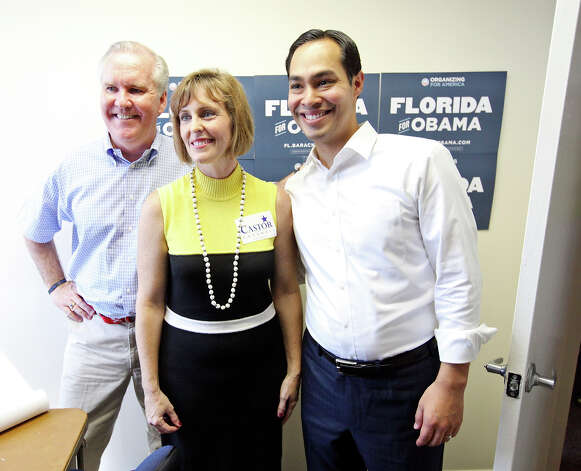 Tampa Mayor Bob Buckhorn (from left), U.S. Rep. Kathy Castor, D-Fla., and Mayor Julián Castro pose for photos during the opening of the 100th field office for the Obama For America-Florida campaign Saturday, Sept. 29, 2012, in Tampa, Fla. The trio were on hand to rally the troops for canvassing. Castro later met with other campaign members who were headed out specifically to help register voters in Florida, where there are 10 days left to do so. Photo: Edward A. Ornelas, San Antonio Express-News / © 2012 San Antonio Express-News