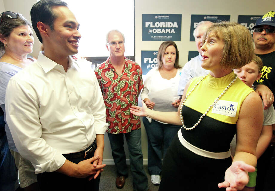 Mayor Julián Castro (left) jokes with U.S. Rep. Kathy Castor, D-Fla., during the opening of the 100th field office for the Obama For America-Florida campaign Saturday, Sept. 29, 2012, in Tampa, Fla. Castro later met with other campaign members who were headed out specifically to help register voters in Florida, where there are 10 days left to do so. Photo: Edward A. Ornelas, San Antonio Express-News / © 2012 San Antonio Express-News