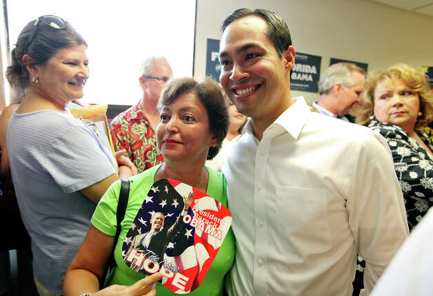 Milagros Cummins (left) poses for photos with Mayor Julián Castro after he spoke at the opening of the 100th field office for the Obama For America-Florida campaign Saturday, Sept. 29, 2012, in Tampa, Fla. He was joined by Tampa Mayor Bob Buckhorn and U.S. Rep. Kathy Castor, D-Fla. The trio were on hand to rally the troops for canvassing. Castro later met with other campaign members who were headed out specifically to help register voters in Florida, where there are 10 days left to do so. Photo: Edward A. Ornelas, San Antonio Express-News / © 2012 San Antonio Express-News