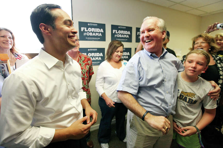 Mayor Julián Castro (left) jokes with Tampa Mayor Bob Buckhorn and his daughter Grace Buckhorn, 11,  during the opening of the 100th field office for the Obama For America-Florida campaign Saturday, Sept. 29, 2012, in Tampa, Fla. He was joined by Tampa Mayor Bob Buckhorn and U.S. Rep. Kathy Castor, D-Fla. The trio were on hand to rally the troops for canvassing. Castro later met with other campaign members who were headed out specifically to help register voters in Florida, where there are 10 days left to do so. Photo: Edward A. Ornelas, San Antonio Express-News / © 2012 San Antonio Express-News