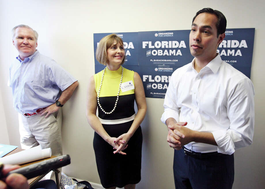 Tampa Mayor Bob Buckhorn (from left) and U.S. Rep. Kathy Castor, D-Fla., look on as Mayor Julián Castro answers questions from the media during the opening of the 100th field office for the Obama For America-Florida campaign Saturday, Sept. 29, 2012, in Tampa, Fla. The trio were on hand to rally the troops for canvassing. Castro later met with other campaign members who were headed out specifically to help register voters in Florida, where there are 10 days left to do so. Photo: Edward A. Ornelas, San Antonio Express-News / © 2012 San Antonio Express-News