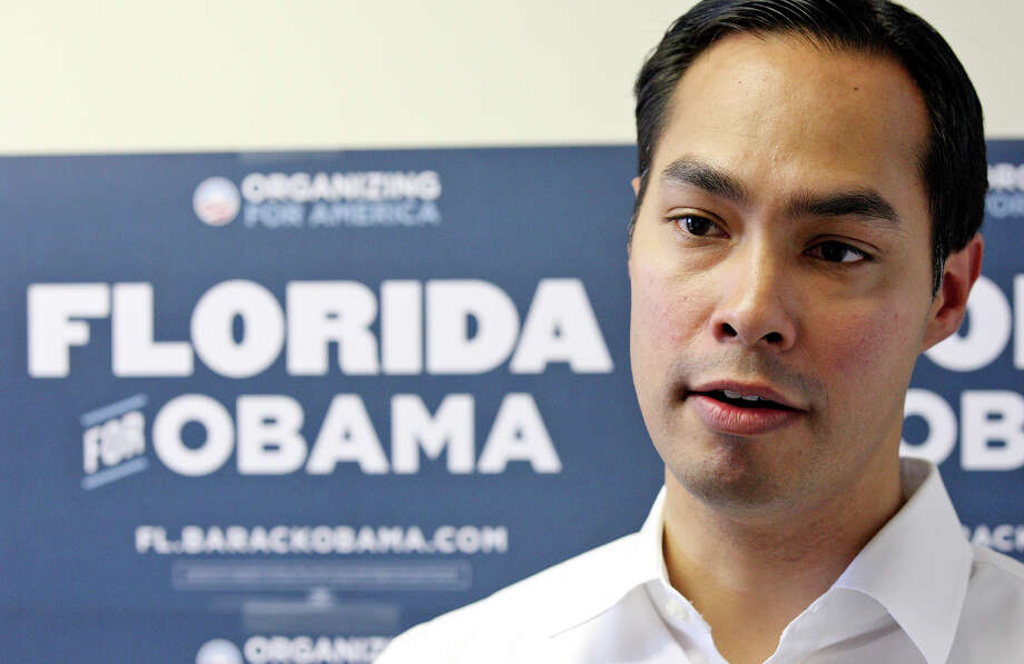Mayor Julián Castro answers questions from the media during the opening of the 100th field office for the Obama For America-Florida campaign Saturday, Sept. 29, 2012, in Tampa, Fla. He was joined by Tampa Mayor Bob Buckhorn and U.S. Rep. Kathy Castor, D-Fla. (not pictured). The trio were on hand to rally the troops for canvassing. Castro later met with other campaign members who were headed out specifically to help register voters in Florida, where there are 10 days left to do so. Photo: Edward A. Ornelas, San Antonio Express-News / © 2012 San Antonio Express-News