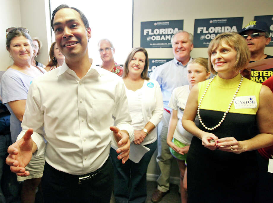 Mayor Julián Castro (from left) speaks during the opening of the 100th field office for the Obama For America-Florida campaign Saturday, Sept. 29, 2012, in Tampa, Fla., as Tampa Mayor Bob Buckhorn (center rear blue shirt) his daughter Grace Buckhorn, 11, U.S. Rep. Kathy Castor, D-Fla., and others look on. The trio were on hand to rally the troops for canvassing. Castro later met with other campaign members who were headed out specifically to help register voters in Florida, where there are 10 days left to do so. Photo: Edward A. Ornelas, San Antonio Express-News / © 2012 San Antonio Express-News