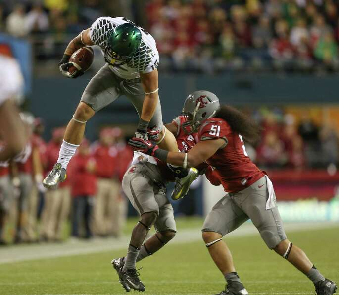 SEATTLE, WA - SEPTEMBER 29:  Tight end Colt Lyerla #15 of the Oregon Ducks leaps over linebacker
