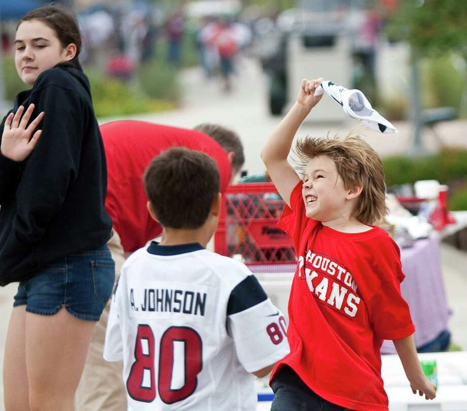 Jake Hewett, 8, of Sugar Land and his friends show their excitement for the Houston Texans game against the Tennessee Titans outside Reliant Stadium on Sunday, Sept. 30, 2012, in Houston. Photo: Nick De La Torre, Houston Chronicle / © 2012  Houston Chronicle