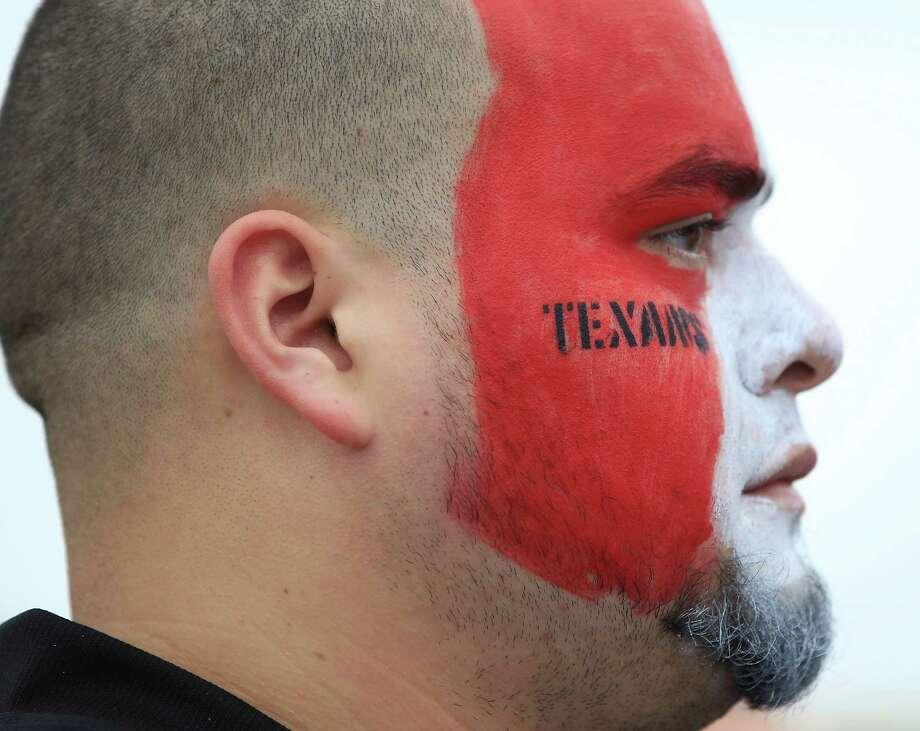 Alvaro Marquez, of Houston, sports hit face paint at Reliant Stadium on Sunday, Sept. 30, 2012, in Houston. Photo: Karen Warren, Houston Chronicle / © 2012  Houston Chronicle