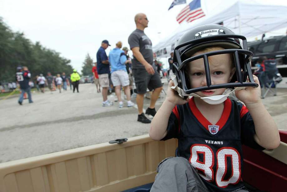 Jacobi Stegman, 2, named after Jacobi Jones, puts on his game face in the blue lot at Reliant Stadium on Sunday, Sept. 30, 2012, in Houston. Photo: Karen Warren, Houston Chronicle / © 2012  Houston Chronicle