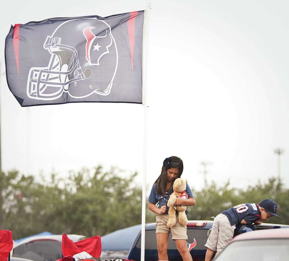 Alenna Alvarado, 7, and her little brother Andrew Alvarado, 4, both of Victoria as their parents Houston Texans game against the Tennessee Titans outside Reliant Stadium on Sunday, Sept. 30, 2012, in Houston. Photo: Nick De La Torre, Houston Chronicle / © 2012  Houston Chronicle