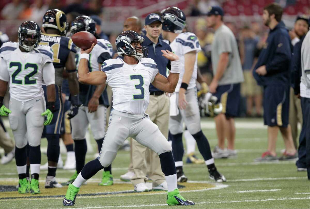 Seattle Seahawks quarterback Russell Wilson throws before an NFL football game against the St. Louis Rams Sunday, Sept. 30, 2012, in St. Louis.
