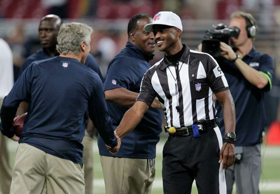 Seattle Seahawks head coach Pete Carroll, left, greets referee Mike Carey (94) before an NFL football game against the St. Louis Rams Sunday, Sept. 30, 2012, in St. Louis. Photo: AP