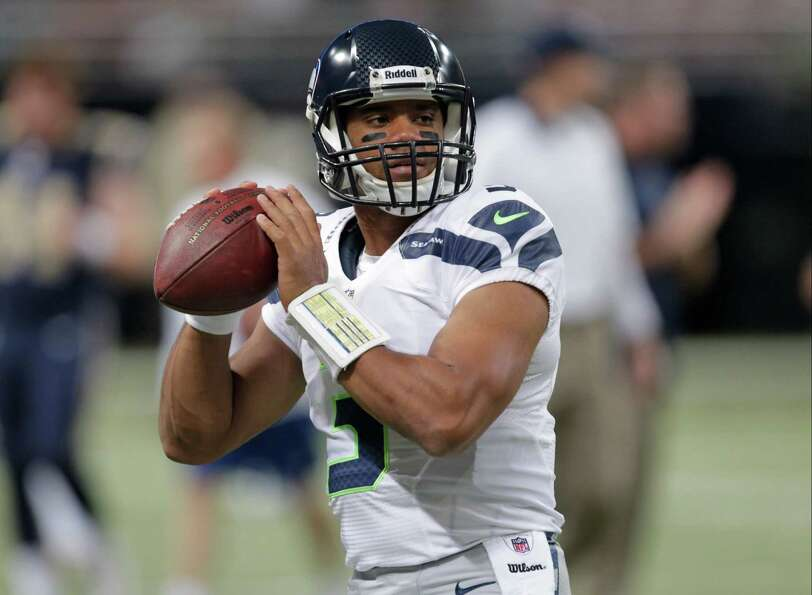 Seattle Seahawks quarterback Russell Wilson throws before anNFL football game against the St. Louis