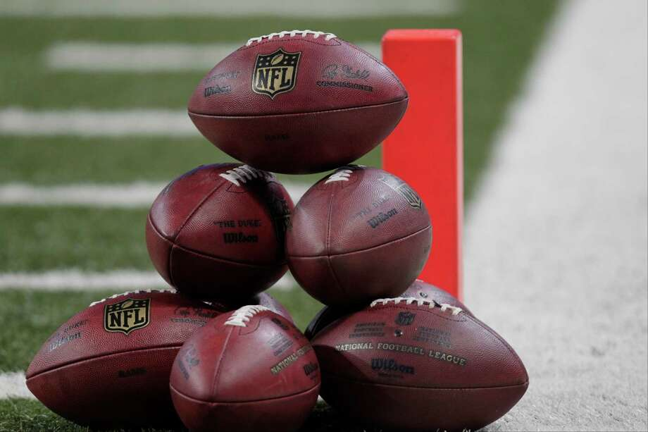 NFL footballs are displayed on the field before an NFL football game between the Seattle Seahawks and St. Louis Rams Sunday, Sept. 30, 2012, in St. Louis. Photo: AP