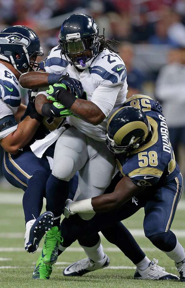 Seattle Seahawks running back Marshawn Lynch (24) is tackled by St. Louis Rams outside linebacker Jo-Lonn Dunbar (58) during the first half of an NFL football game Sunday, Sept. 30, 2012, in St. Louis. Photo: AP