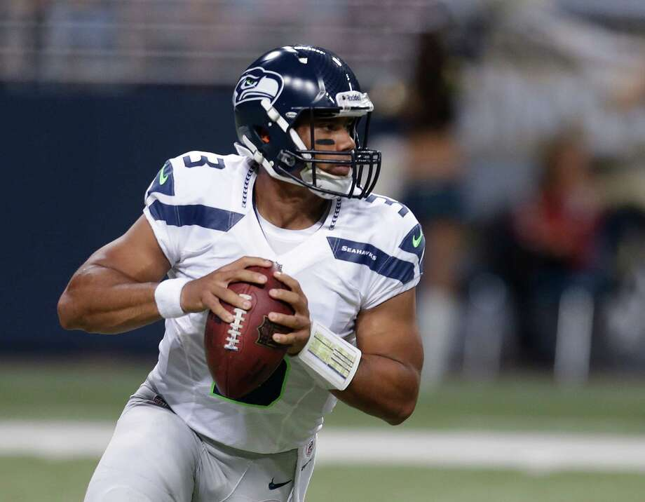 Seattle Seahawks quarterback Russell Wilson looks to pass during the first half of an NFL football game against the St. Louis Rams Sunday, Sept. 30, 2012, in St. Louis. Photo: AP