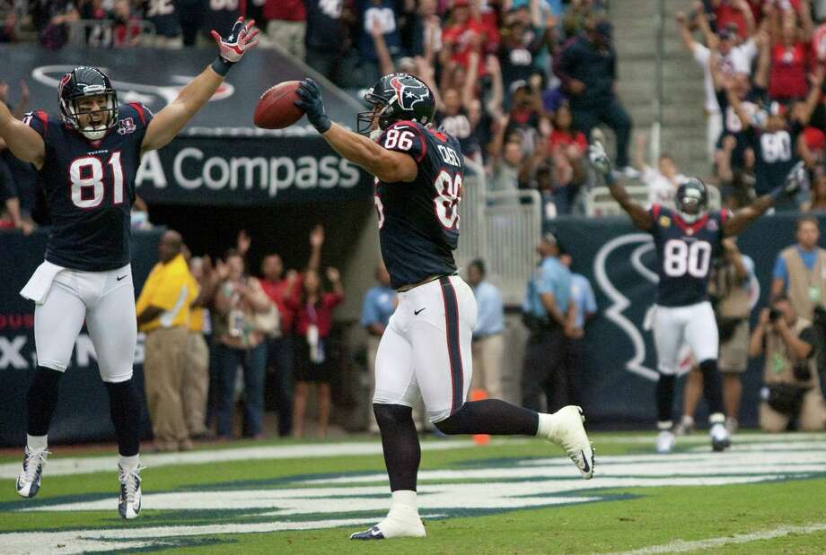 Houston Texans fullback James Casey (86) celebrates with  Owen Daniels (81) as he scores on an 11-yard touchdown pass during the first quarter against the Tennessee Titans at Reliant Stadium on Sunday, Sept. 30, 2012, in Houston. Photo: Karen Warren, Houston Chronicle / © 2012  Houston Chronicle