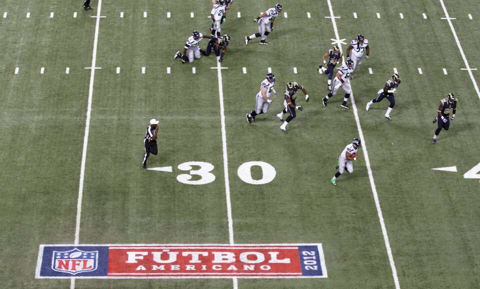 The Hispanic Heritage logo is seen on the field during an NFL football game between the Seattle Seah