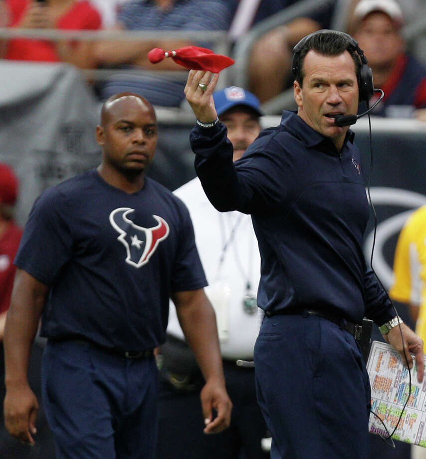 Houston Texans head coach Gary Kubiak throws a challenge flag during the first quarter against the Tennessee Titans at Reliant Stadium on Sunday, Sept. 30, 2012, in Houston. Photo: Brett Coomer, Houston Chronicle / © 2012  Houston Chronicle