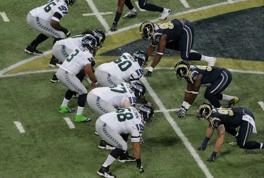 Seattle Seahawks quarterback Russell Wilson (3) calls a play during the first half of an NFL football game against the St. Louis Rams Sunday, Sept. 30, 2012, in St. Louis. Photo: AP