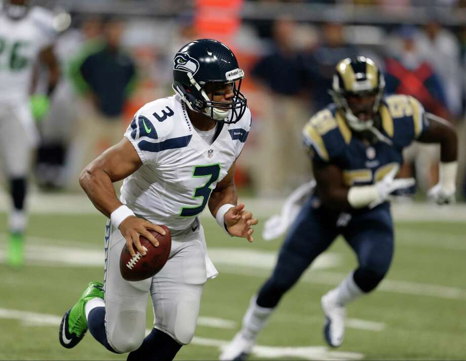 Seattle Seahawks quarterback Russell Wilson (3) runs from St. Louis Rams outside linebacker Jo-Lonn Dunbar during the first half of an NFL football game Sunday, Sept. 30, 2012, in St. Louis. Photo: AP