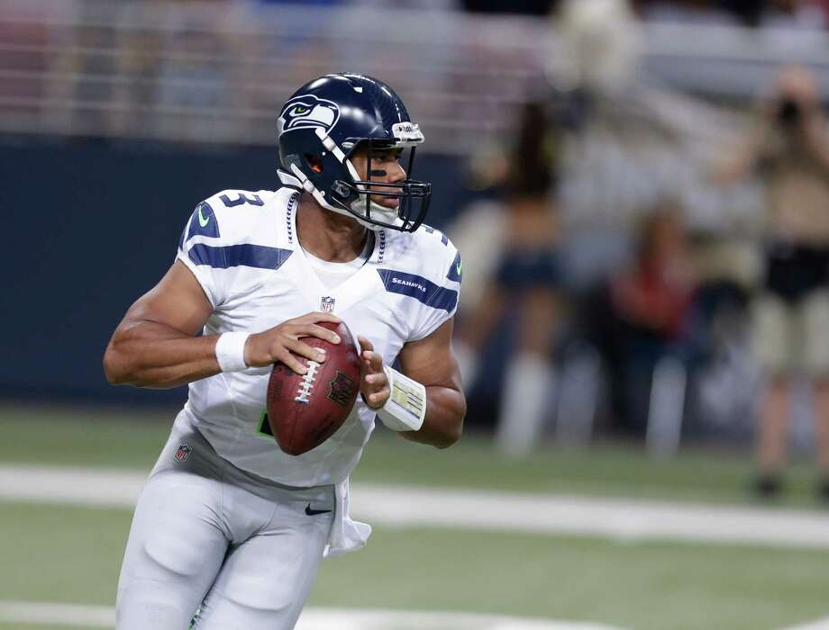 Seattle Seahawks quarterback Russell Wilson looks to pass