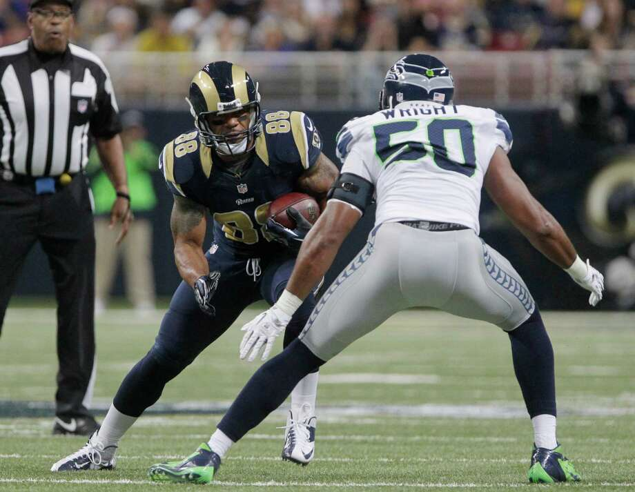 St. Louis Rams tight end Lance Kendricks is defended by Seattle Seahawks outside linebacker K.J. Wright during the first half of an NFL football game Sunday, Sept. 30, 2012, in St. Louis. Photo: AP