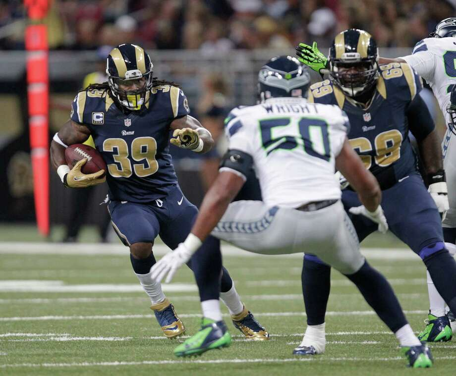 St. Louis Rams  Steven Jackson runs against Seattle Seahawks outside linebacker K.J. Wright (50) fduring the first half of an NFL football game Sunday, Sept. 30, 2012, in St. Louis. Photo: AP
