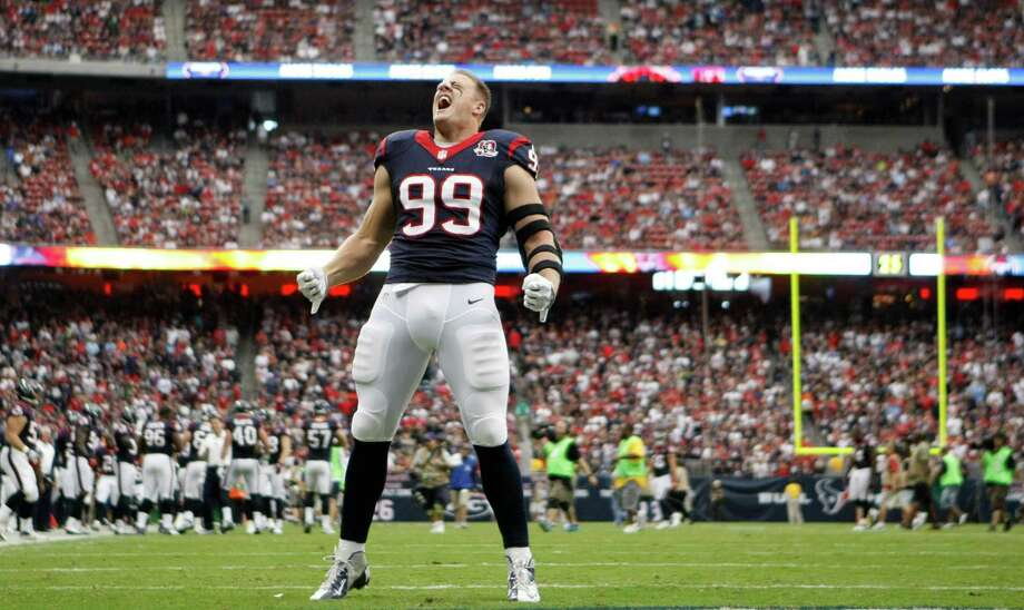 Houston Texans defensive end J.J. Watt lets out a yell before facing the Tennessee Titans at Reliant Stadium on Sunday, Sept. 30, 2012, in Houston. Photo: Karen Warren, Houston Chronicle / © 2012  Houston Chronicle