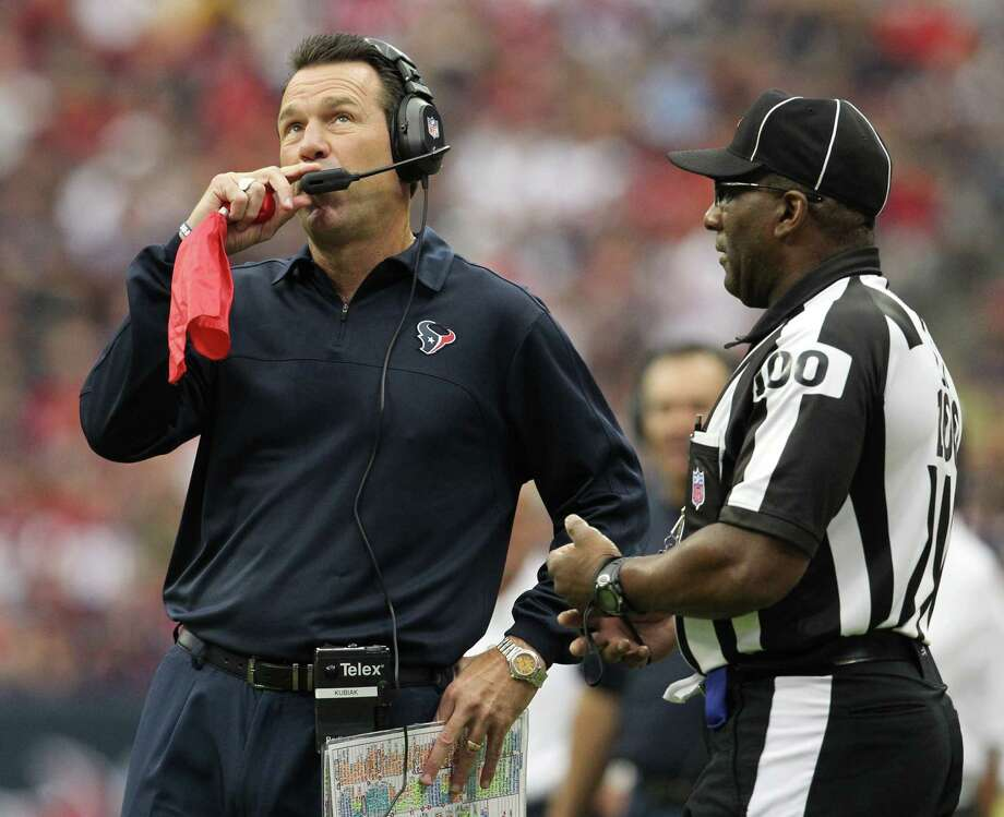 Houston Texans head coach Gary Kubiak watches a replay before throwing a challenge flag during the first quarter against the Tennessee Titans at Reliant Stadium on Sunday, Sept. 30, 2012, in Houston. Photo: Karen Warren, Houston Chronicle / © 2012  Houston Chronicle