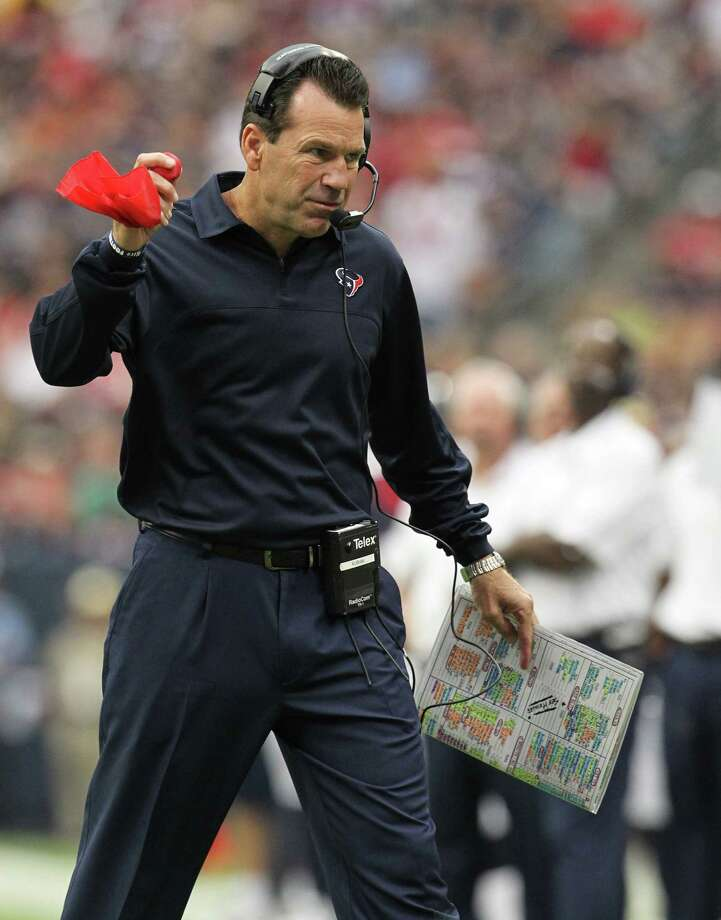 Houston Texans head coach Gary Kubiak throws the challenge flag during the first quarter against the Tennessee Titans at Reliant Stadium on Sunday, Sept. 30, 2012, in Houston. Photo: Karen Warren, Houston Chronicle / © 2012  Houston Chronicle