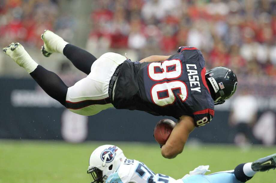 Houston Texans fullback James Casey (86) is upended by Tennessee Titans cornerback Alterraun Verner (20) during the first quarter at Reliant Stadium on Sunday, Sept. 30, 2012, in Houston. Photo: Karen Warren, Houston Chronicle / © 2012  Houston Chronicle