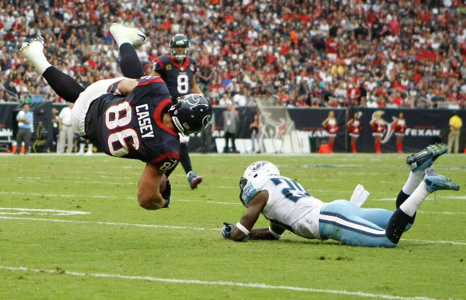 Houston Texans fullback James Casey (86) is upended by Tennessee Titans cornerback Alterraun Verner (20) during the first quarter at Reliant Stadium on Sunday, Sept. 30, 2012, in Houston. Photo: Nick De La Torre, Houston Chronicle / © 2012  Houston Chronicle