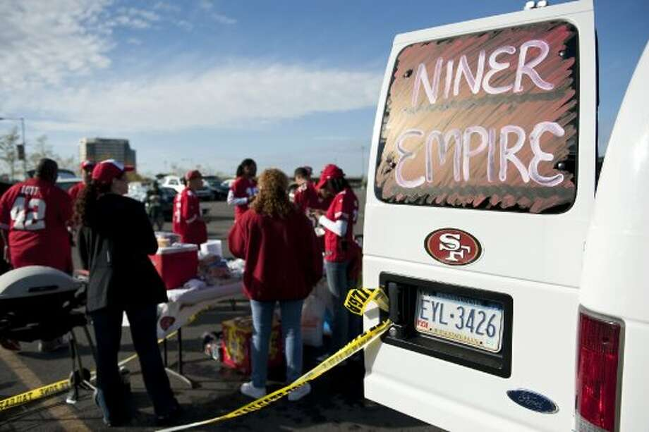 On Sunday, September 30, 2012, fans of the San Francisco 49ers gather in the parking lot of Metlife Stadium before the 49ers play the New York Jets in Rutherford, New Jersey. (Bryan Thomas / Special to the Chronicle)