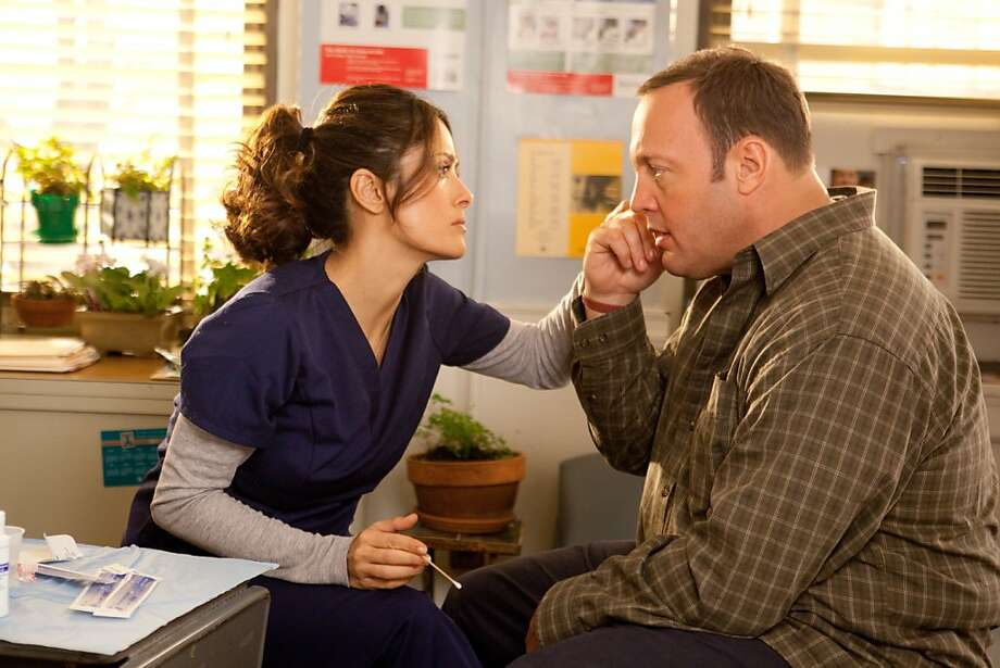 "No. 11: Salma Hayek and Kevin James in ""Here Comes the Boom"" perpetuate the movie myth that if a guy annoys a woman long enough, she will eventually become enamored with him. Photo: Tracy Bennett, Columbia Pictures 2012"