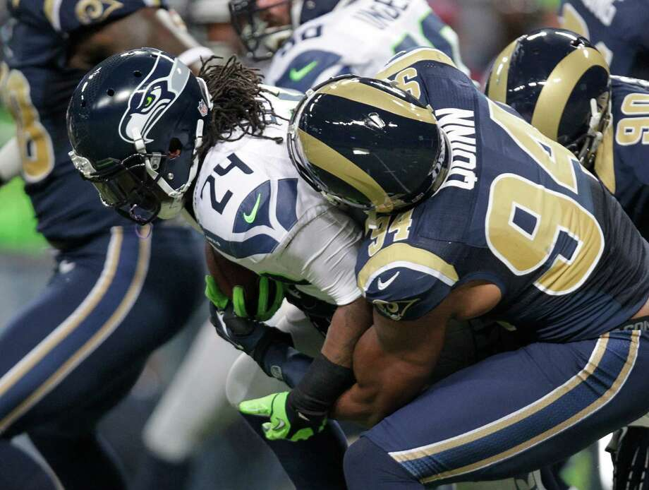 Seattle Seahawks running back Marshawn Lynch (24) is tackled by St. Louis Rams defensive end Robert Quinn during the first half of an NFL football game Sunday, Sept. 30, 2012, in St. Louis. Photo: AP