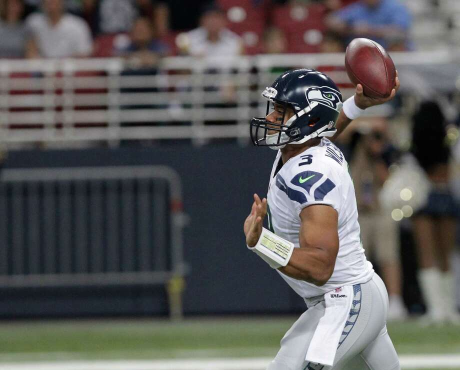 Seattle Seahawks quarterback Russell Wilson (3) throws 