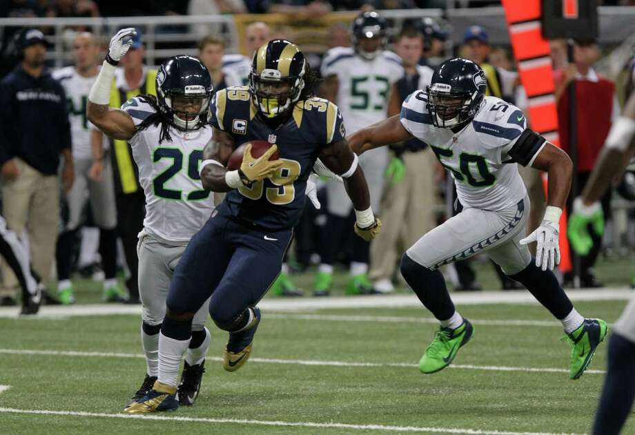 St. Louis Rams running back Steven Jackson (39) runs against Seattle Seahawks free safety Earl Thomas (29) and  K.J. Wright (50)