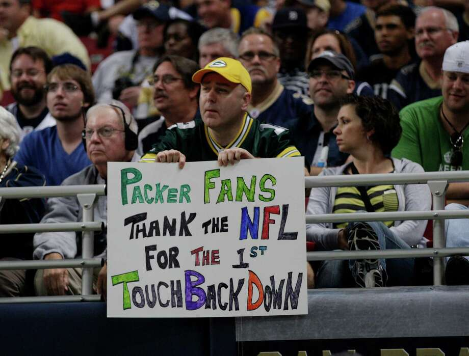 A Green Bay Packers fan displays a sign during the first half of an NFL football game between the Seattle Seahawks and St. Louis Rams Sunday, Sept. 30, 2012, in St. Louis. Photo: AP