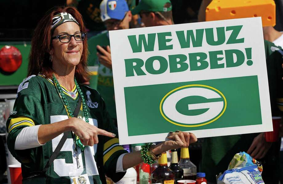 Green Bay Packers fan Laurie Larson holds up a sign in reference to a called made by the replacemeents referees that decided Monday's night game between the Packrs and the Seahawks before an NFL football game Sunday, Sept. 30, 2012 in Green Bay, Wis. between the Packers and the New Orleans Saints. Photo: AP