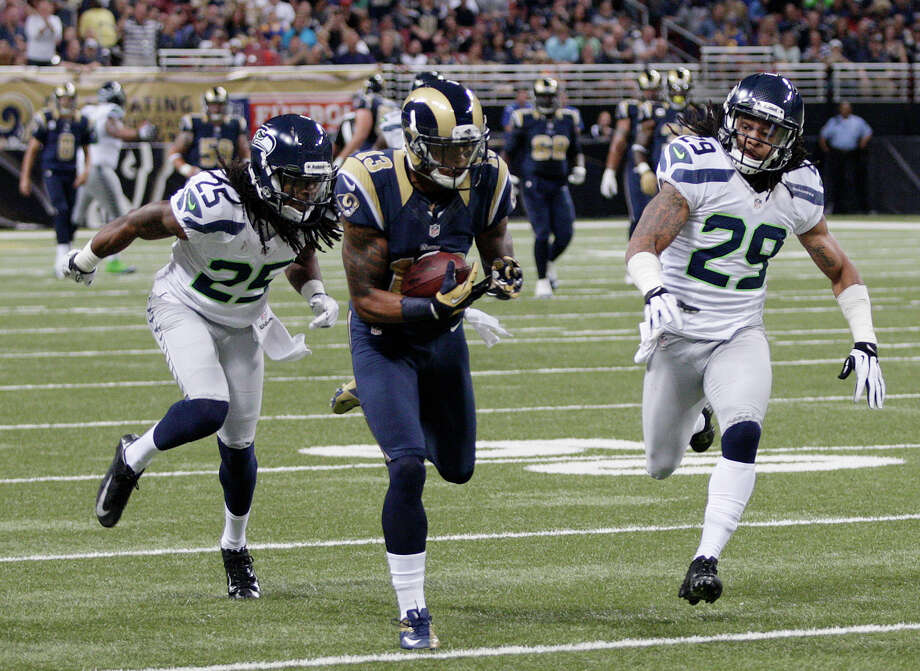 St. Louis Rams wide receiver Chris Givens (13) makes a reception against Seattle Seahawks cornerback Richard Sherman (25) and  Earl Thomas (29) during the first half of an NFL football game Sunday, Sept. 30, 2012, in St. Louis. Photo: AP