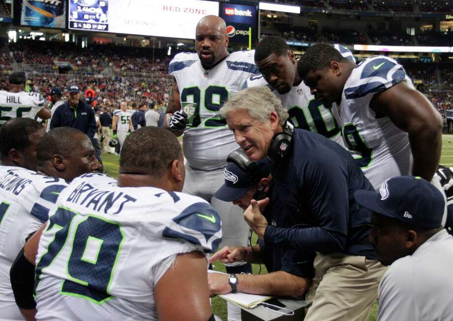 Seattle Seahawks head coach Pete Carroll talks to his team during the first half of an NFL football game against the St. Louis Rams Sunday, Sept. 30, 2012, in St. Louis. Photo: AP