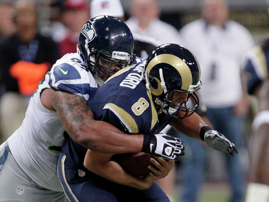 St. Louis Rams quarterback Sam Bradford (8) is sacked by Seattle Seahawks defensive tackle Alan Branch during the first half of an NFL football game Sunday, Sept. 30, 2012, in St. Louis. Photo: AP