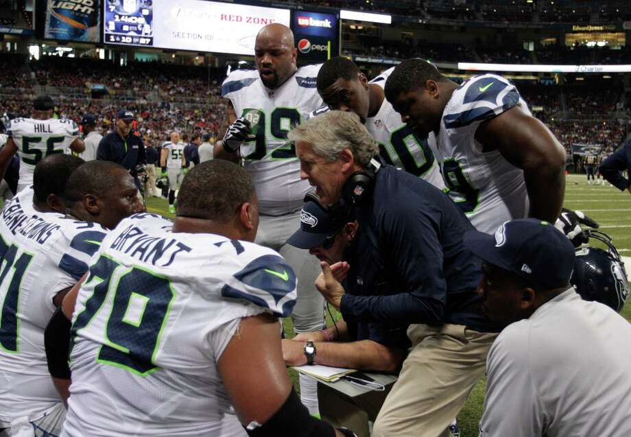Seattle Seahawks head coach Pete Carroll talks to his team 
