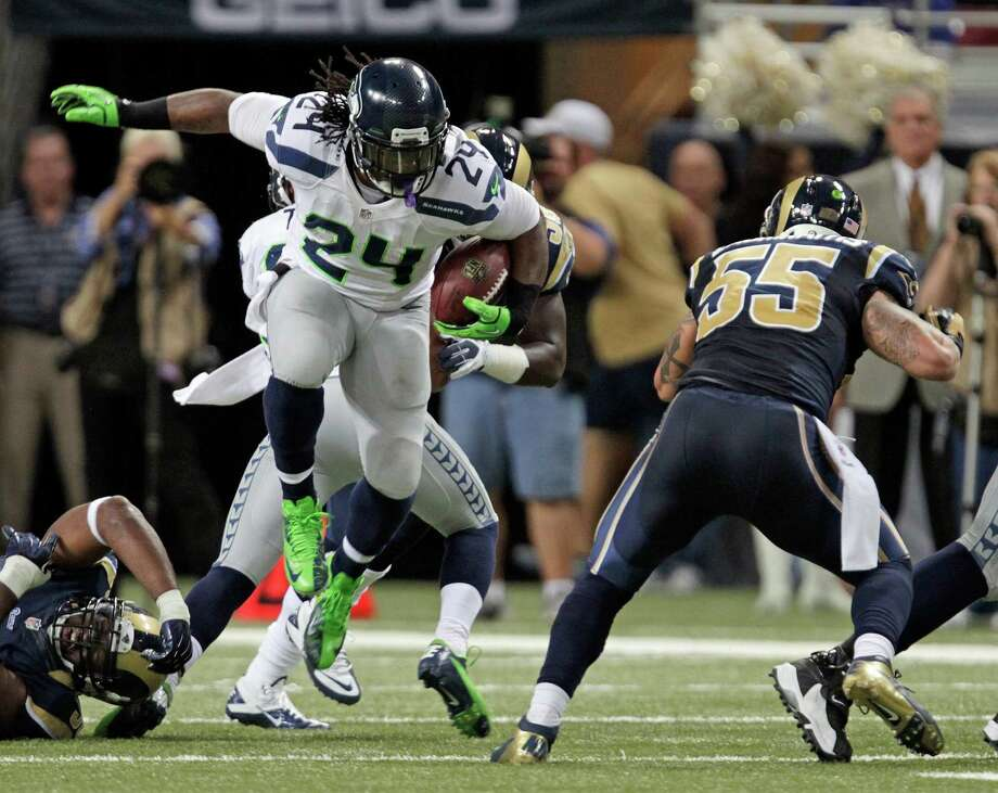 Seattle Seahawks running back Marshawn Lynch (24) runs against St. Louis Rams middle linebacker James Laurinaitis (55) during the first half of an NFL football game Sunday, Sept. 30, 2012, in St. Louis. Photo: AP