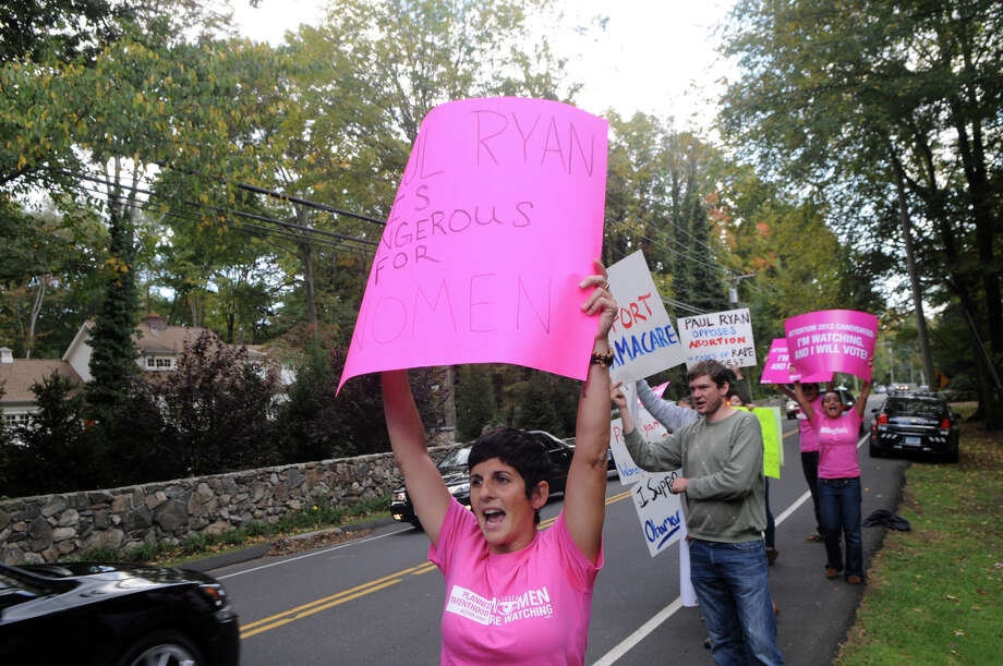 Gretchen Raffa and members of the Yale Student Health and Aids Coalition and Planned Parenthood Voted Connecticut gather to protest outside Woodway Country Club where Vice President candidate Paul Ryan's joined supporters for an event on Hoyt Street in Darien, Conn., Saturday, Sept. 30, 2012. Photo: Keelin Daly / Stamford Advocate