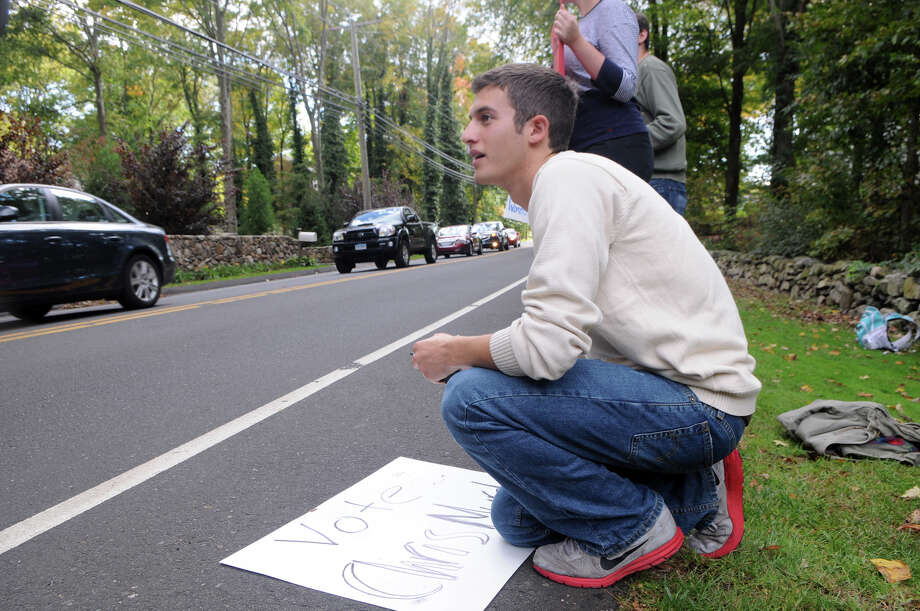 David Carel, a founding member of the Yale Student Health and Aids Coalition, joins member of his group and Planned Parenthood Voted Connecticut to protest outside Woodway Country Club where Vice President candidate Paul Ryan's joined supporters for an event on Hoyt Street in Darien, Conn., Saturday, Sept. 30, 2012. Photo: Keelin Daly / Stamford Advocate